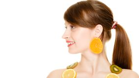 Diet. Girl with necklace of fresh citrus fruits isolated Royalty Free Stock Image