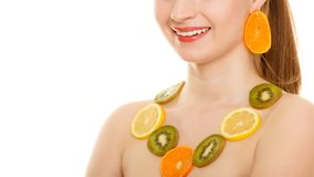 Diet. Girl with necklace of fresh citrus fruits isolated Royalty Free Stock Photo