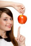 Diet. Girl offering apple seasonal fruit. Diet and nutrition. Happy young woman offering apple seasonal fruit isolated on white. Girl recommending healthy Stock Photo