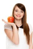 Diet. Girl offering apple seasonal fruit. Diet and nutrition. Happy young woman offering apple seasonal fruit isolated on white. Girl recommending healthy Stock Photos