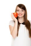 Diet. Girl offering apple seasonal fruit. Diet and nutrition. Happy young woman offering apple seasonal fruit isolated on white. Girl recommending healthy Royalty Free Stock Photography