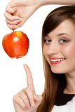 Diet. Girl offering apple seasonal fruit. Stock Images