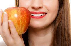 Diet. Girl offering apple seasonal fruit. Diet and nutrition. Happy young woman offering apple seasonal fruit  on white. Girl recommending healthy lifestyle Royalty Free Stock Images