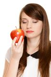 Diet. Girl smelling apple seasonal fruit. Royalty Free Stock Photos