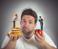 Diet guilty conscience. Man on diet with a guilty conscience stock images