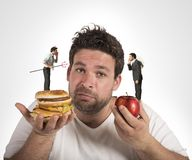 Diet guilty conscience. Man on diet with a guilty conscience royalty free stock photo