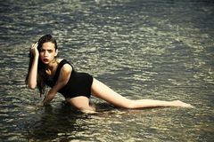 Diet, health, workout, fitness, refresh. Fashion, beauty, ecology. Young woman with red lips in water. Woman swim at beach, nature, wet girl with long hair royalty free stock image