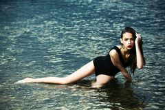 Diet, health, workout, fitness, refresh. Fashion, beauty, ecology. Young woman with red lips in water. Woman swim at beach, nature, wet girl with long hair royalty free stock photos