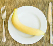 Diet, healthy banana on the white plate - healthy breakfast, wei Royalty Free Stock Photo