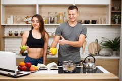Couple bloggers recording video for fitness blog stock image