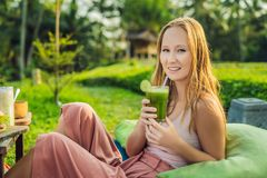 Diet. Healthy Eating Woman Drinking Fresh Raw Green Detox Vegetable Juice. Healthy Lifestyle, Vegetarian Food And Meal royalty free stock image