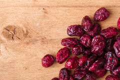 Diet healthy food. Border of dried cranberries on wooden background Royalty Free Stock Photo