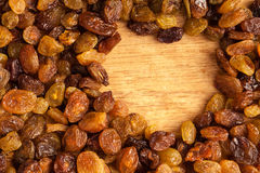 Diet healthy food. Border of raisin on wooden background Stock Photo