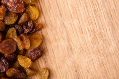 Diet healthy food. Border of raisin on wooden background Royalty Free Stock Image