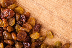 Diet healthy food. Border of raisin on wooden background Royalty Free Stock Photos