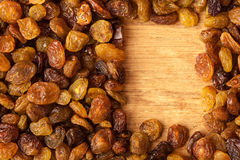 Diet healthy food. Border of raisin on wooden background Stock Image