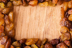 Diet healthy food. Border of raisin on wooden background Stock Photos