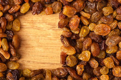 Diet healthy food. Border of raisin on wooden background Stock Images