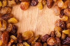 Diet healthy food. Border of raisin on wooden background Royalty Free Stock Photography