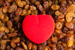 Diet healthy food. Raisin as background texture and red heart Stock Photo