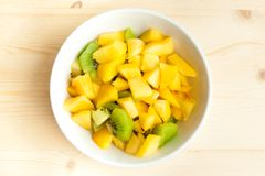 Diet, healthy fruit salad in the white bowl - healthy breakfast Stock Image
