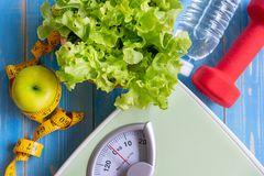 Diet and Healthy life Concept. Green apple and Weight stock photos