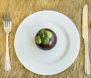 Diet, healthy mangosteen on the white plate - healthy breakfast, Royalty Free Stock Photos