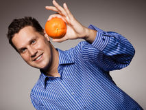 Diet and healthy nutrition. Man recommending orange Stock Image