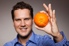Diet and healthy nutrition. Man recommending orange Royalty Free Stock Image