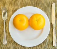Diet, healthy oranges on the white plate - healthy breakfast, we Royalty Free Stock Images