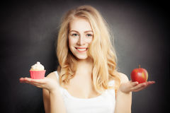 Diet. Healthy Woman Holding Apple and Cake stock images