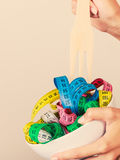 Diet. human hand and measuring tapes in bowl Royalty Free Stock Images