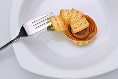Diet idea, fork and centimeter Stock Images