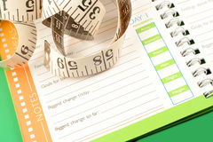 Diet journal. A measuring tape, diet and nutrition journal Royalty Free Stock Photo