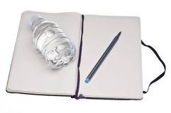 Diet Journal. With Pen and Bottle of Water Isolated on White with a Clipping Path Stock Photos