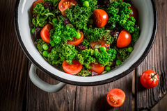 Diet kale salad with green peas and cherry tomatoes Royalty Free Stock Image