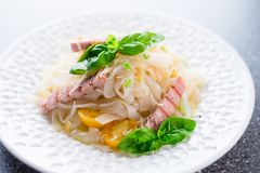 Diet konjac noodles. With cherry tomatoes, tuna and basil Stock Images