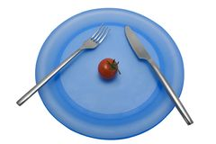 Diet lunch 6. A diet lunch of a single tomato. With clipping path Royalty Free Stock Photography
