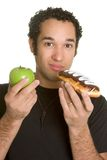 Diet Man. Holding apple donut food stock images