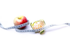 Diet (mandarin and apple) Royalty Free Stock Image
