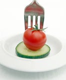 Diet meal. Cucumber and tomato on plate. Diet meal or snack of vegetables Royalty Free Stock Image
