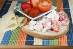 Diet meal. Salad from mozzarella, yogurt, tomato and radish on bread. Vegetable on white plate and cheese Stock Photo