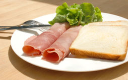 Diet meal. Rolled ham, salad and toast on plate Stock Image