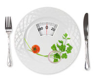 Diet meal. Cherry tomato, parsley and onion in a plate with weight scale Royalty Free Stock Photos