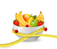 Diet meal. Fruit in a bowl with measuring tape. Royalty Free Stock Images