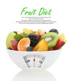 Diet meal. Fruit salad in a bowl. With weight scale Stock Photos