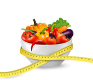 Diet meal. Vegetables in a bowl with measuring tape. Stock Images