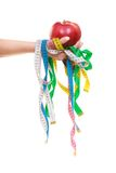 Diet. Measure tapes and apple fruit in hand Royalty Free Stock Images