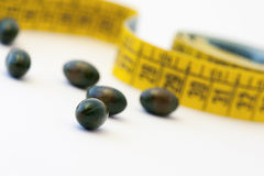 Diet - measuring tape and pills Stock Photography