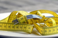 Diet, measuring tape instead of spaghetti Royalty Free Stock Image